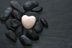 Stone heart and other stones abstract background Stock Photography