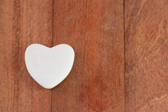 Stone heart on red wood Stock Image