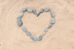 Stone Heart on Sand Royalty Free Stock Photos
