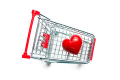 Stone heart in shopping cart Stock Photo