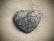 Stone heart standing on beach sand. 3D illustration.  Royalty Free Stock Images