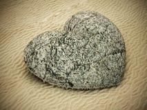Stone heart standing on beach sand. 3D illustration.  Stock Photos