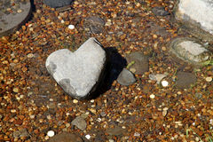 Stone Heart in a stream.  Japanese garden. Royalty Free Stock Photo