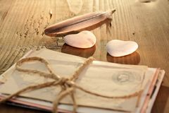 Stone heart with tied letters stock image