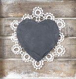 Stone heart on wooden background. Stone heart and lace on wooden background Stock Photo