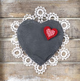 Stone heart on wooden background. Stone heart and lace on old wooden background Stock Image