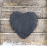 Stone heart on wooden background. Stone heart on old  wooden background Stock Photos