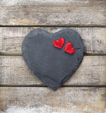 Stone heart on wooden background Stock Photo