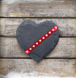 Stone heart on wooden background Stock Photos