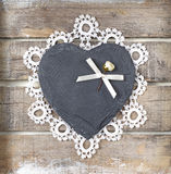 Stone heart on wooden background. Stone heart and rose on old wooden background Royalty Free Stock Images
