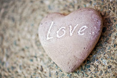 Stone heart with the word - Love - on it Stock Photos