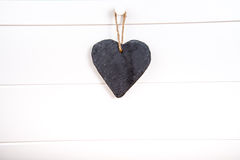 Stone hearth shape sign hanging on door Stock Photo