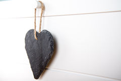 Stone hearth shape sign hanging on door Stock Photos