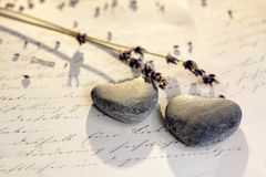 Stone hearts with old letter Royalty Free Stock Photo
