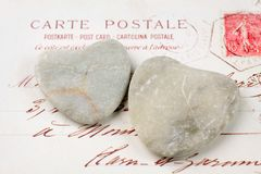 Stone hearts with postcard Stock Image