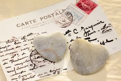 Stone hearts with postcard Royalty Free Stock Photography