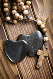 Stone hearts with rosary beads Stock Image