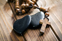 Stone hearts with rosary beads Stock Images