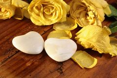 Stone hearts and roses Royalty Free Stock Images