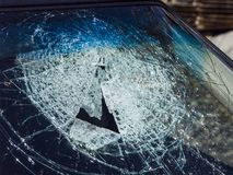 Stone hits of  a windshield. Fragmented windshield of a passenger car after a traffic accident Royalty Free Stock Photography