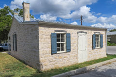 Stone home built before 1880 in Fredericksburg Texas. With shuttered windows and metal roof Royalty Free Stock Photos