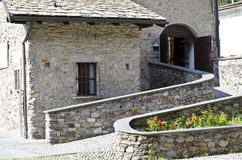 Stone home. Natural stone landscaping in home garden with stairs Royalty Free Stock Photography