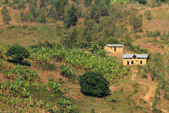 Stone Homes on a hill. A couple of stone houses bult on the side of a hill in Africa stock photography