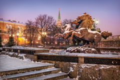 Stone horses rushing gallop. In a snowy morning in Alexandrovsky Garden Stock Image