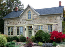 Stone House. Century, field-stone house with landscaped front yard stock photos