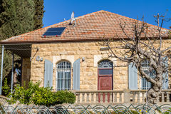 Stone house, arched windows with shutters, Jerusalem Stock Images