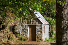 Stone house in the Balcoes hiking route in the rain forests of Madeira Royalty Free Stock Photography