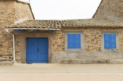 Stone house with blue door and windows in Castilla Leon, Camino de santiago Stock Images