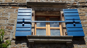 Stone House with Blue Window Shutters Royalty Free Stock Images