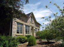 Stone House. Century, field-stone house with landscaped front yard stock photo