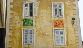 Stone house with colorful decoration wall, windows in the street of old town, beautiful architecture, sunny day, Split, Dalmatia,. Stone house with colorful royalty free stock image