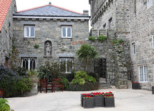 Stone House and Courtyard with planters Royalty Free Stock Photography