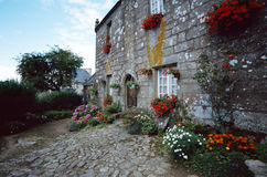 Stone house and flowers garden in brittany, France Stock Photography