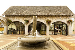 Stone house with fountain Saint-Mamet-la-Salvetat stock photo