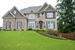 Stone House on Green Hill on White Royalty Free Stock Image