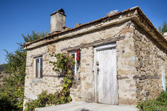 Stone house with Hanging dried red peppers Stock Photo