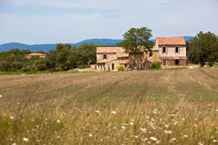 Stone house in a harvested field, France Royalty Free Stock Photo