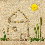 Stone house illustration in sand Stock Image