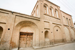 Stone house in the Iranian style masonry and wooden door in a narrow street of the old city Stock Photo