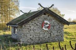 Stone house with life buoy Stock Photo