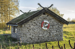 Stone house with life buoy Royalty Free Stock Photos