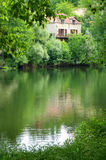 Stone house on Lot River, southern France royalty free stock photos
