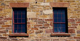 Old windows in stone wall stock photography