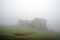 Stone house in the mountain with fog Royalty Free Stock Photos
