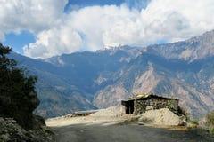 Stone House in Mountains Stock Photo