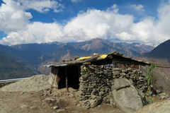 Stone House in Mountains Stock Images